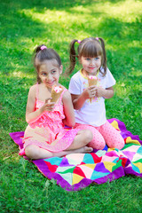 Kids eating ice cream, focus on younger girl's face