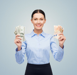 businesswoman with dollar and euro cash money