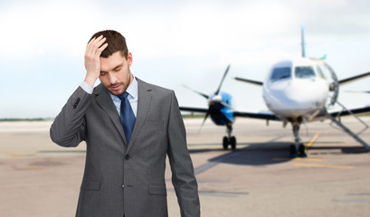 businessman over airplane on runway background