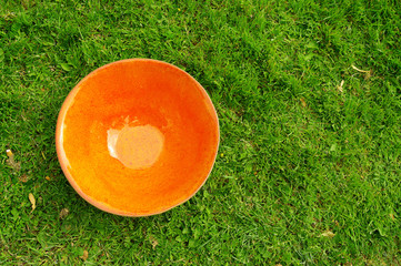 orange  clay pottery plate at the fair of artisans in Riga