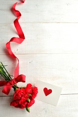 Red carnations bouquet with message card