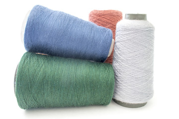 colorful background from threads and yarns isolated over white