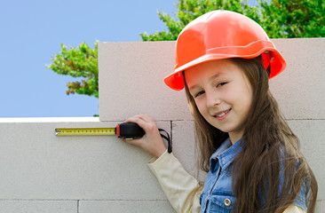 child in a protective construction helmet