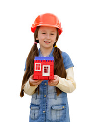 Nice little girl with the toy house in an orange helmet the iso