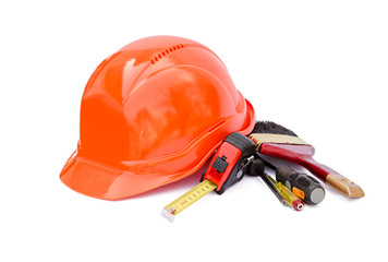 Protective construction helmet and tools on a white background