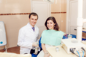 The dentist treats teeth beautiful girl