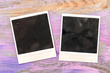 Vintage style photo frames over rustic wooden background