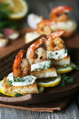 Appetizer canape with shrimp and lemon