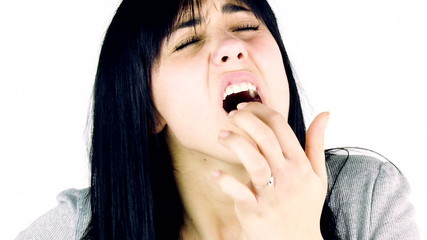 Young brunette woman feeling strong teeth ache isolated closeup
