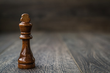 Black King, Chess Piece on a Wooden Table