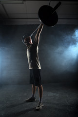 Athlete performs a barbell exercise