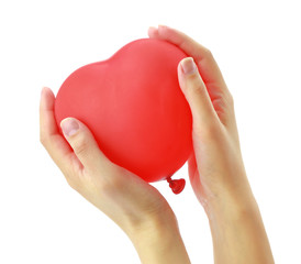 Red heart balloon in womans hands