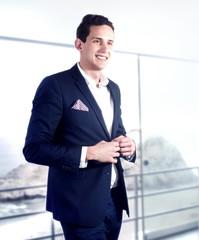 Handsome man posing in suit.