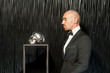 Stylish man in suit in interior see an iron skull