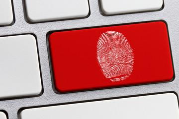 A fingerprint over the Enter key of a computer keyboard