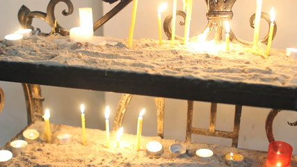 Candles burning in Catholic Church on Easter Sunday