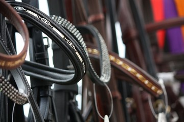Close up of horse bridles in shop