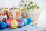 Easter Kulich cake with icing and colored eggs