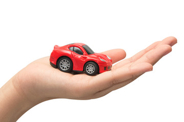 hand holding the model of car. symbol photo for car purchase