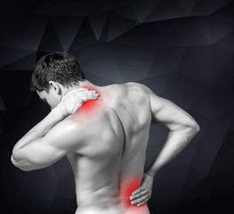 Pain. A boy felt back pain on white background
