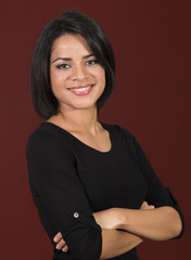 Beautiful latin woman smiling with her arms crossed