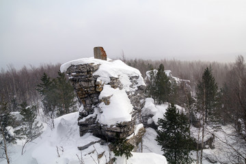 Lone rock in the winter forest