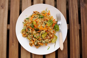 Fried rice with carrot and brussel sprouts in white plate