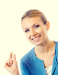 Smiling blond woman with Omega 3 fish oil capsule