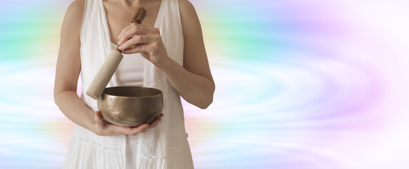 Female Sound Healer usingTibetan Singing Bowl
