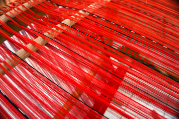 loom with red threads