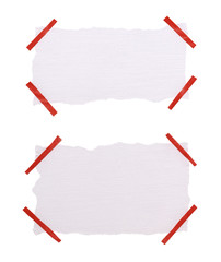 paper label attached with sticky tape on white background
