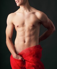 nude male body with a red cloth