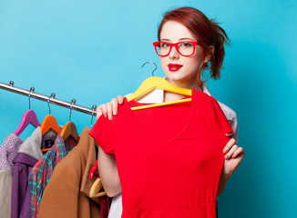 Young redhead designer with dress