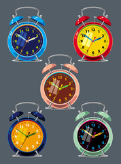 Set of a different colored alarm clocks