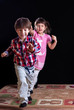 Children playing on a black background