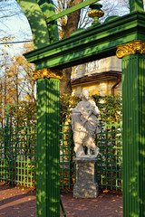 Arches and marble statue  in Summer garden.