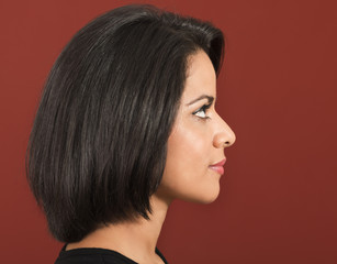 Beautiful latin woman side view and smiling