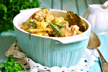 Rabbit stewed with potato in a cream sauce.