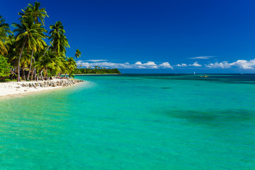 Tropical island in Fiji with sandy beach and clean water