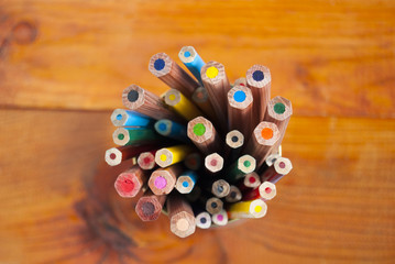 colored pencils on a wooden table