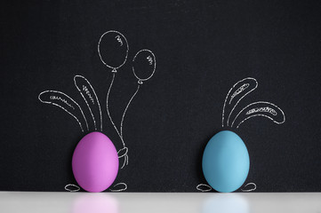 Easter eggs witn painted Easter Bunny on the blackboard