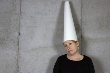 Woman in Dunce Cap, Blank Wall