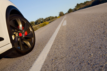 Wheel on a road.