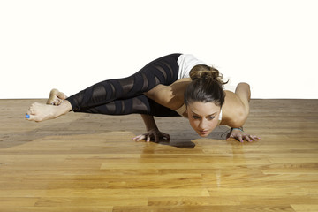 Female Yoga Astavakrasana Eight Angle Pose
