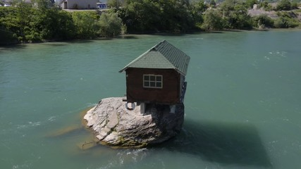 small house built on the rock in the river Drina