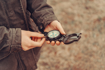 Hiker woman holding a compass outdoor