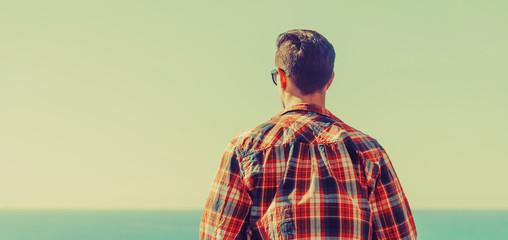 Young man enjoying view of sea