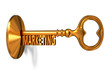 Marketing - Golden Key is Inserted into the Keyhole.