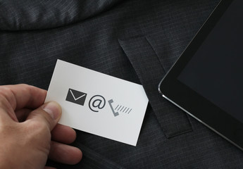close up of businessman hand picking business card icon contact