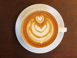 "Latte Coffee art ""Tulip"" on the wooden desk."